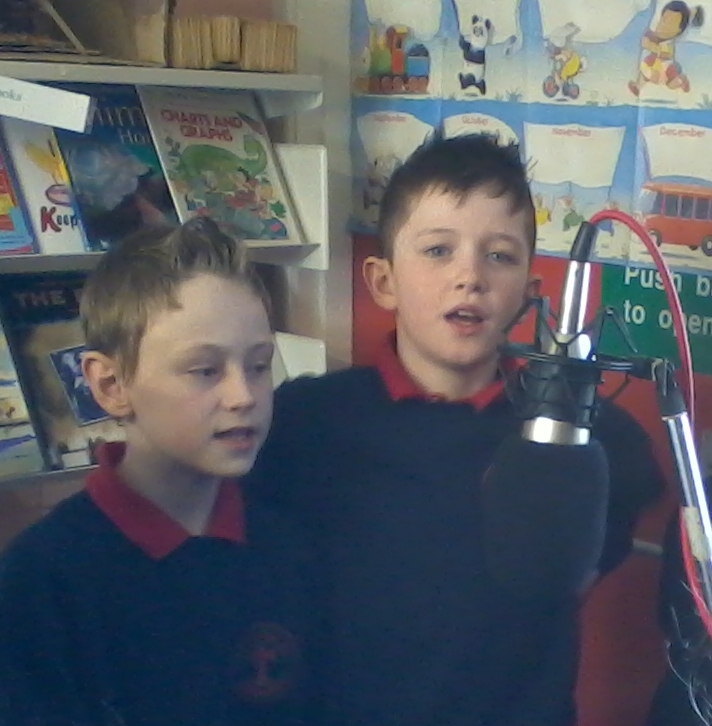 Boys from St Davog's Primary School, Scraghey recite their poems for the audio recording