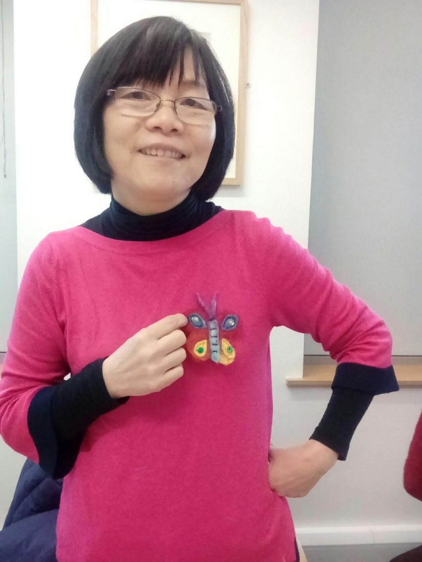 Jennifer Yu - group leader, proudly showing the felted butterfly broach.